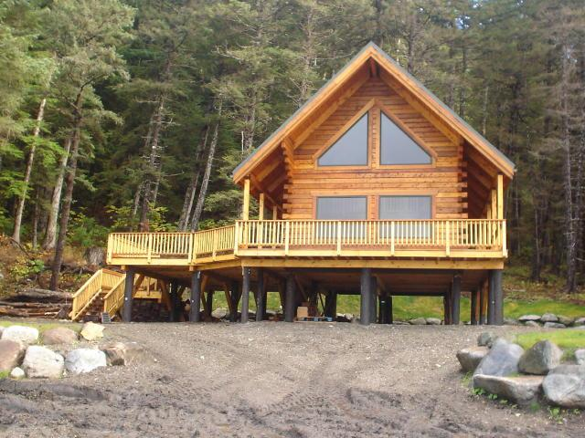 cabin cool images alaska sales estate in track on coldest exterior log house for buy w with keeping estatealaska kenai the homes home cabins real sale bigstock